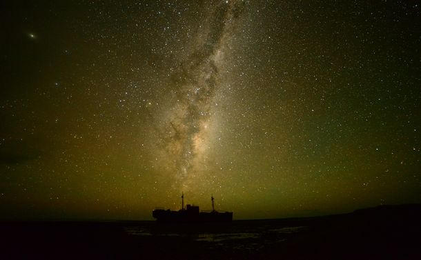 The central part of the Milky Way over the coastal part Patagonia, in Argentina. It is a very remote area, with an old shipwreak (abandoned ship that crashed in the 1980's). There are no villages around so there is zero light pollution.