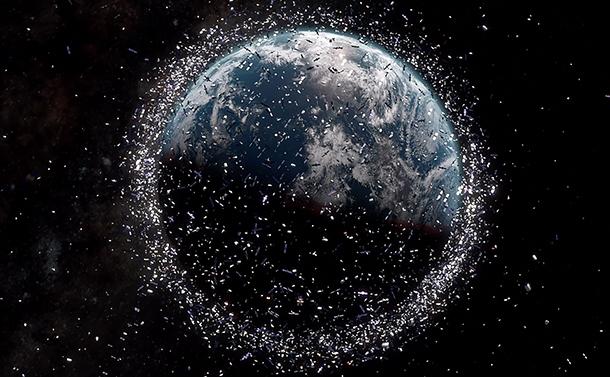 写真・図版 : 宇宙ゴミの数や位置を示すイラスト。ゴミの大きさは強調されている(ESA)