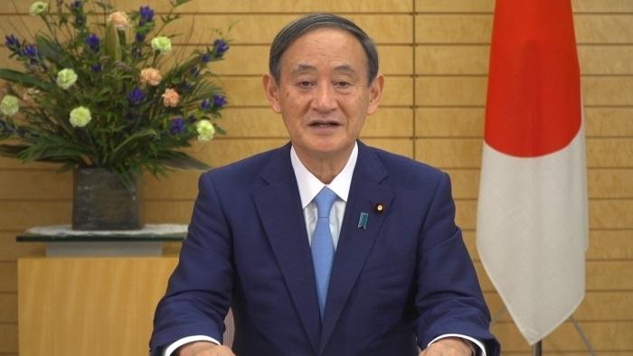 写真・図版 : 事前録画した映像を通じて、国連総会での一般討論演説を行う菅義偉首相=外務省提供