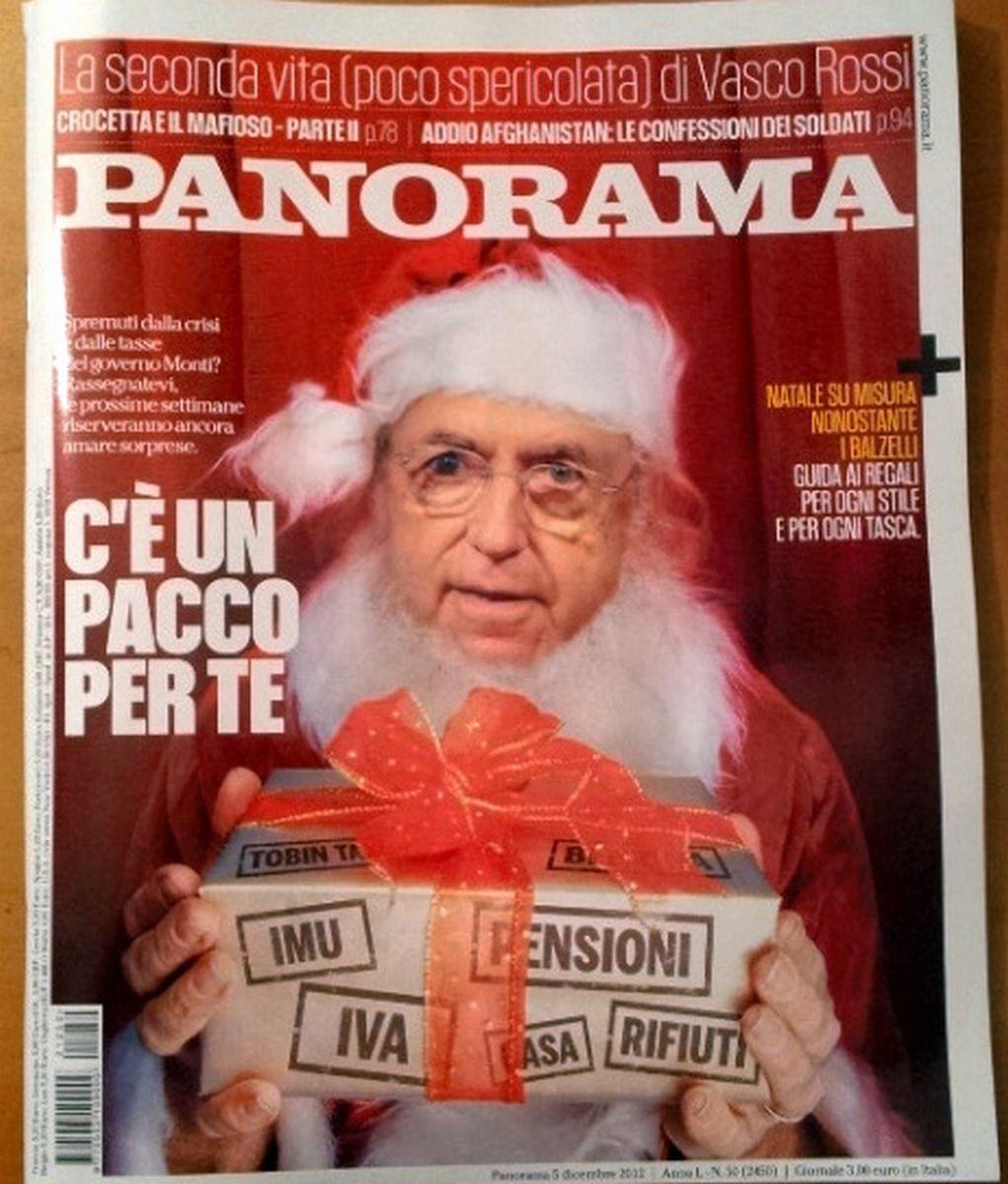 写真・図版 : マリオ・モンティ首相(当時)を表紙にあしらったイタリア誌。「増税案」のプレゼントを手にしたサンタクロース姿だ。国民に不評の緊縮策をやゆしたもの=2012年12月