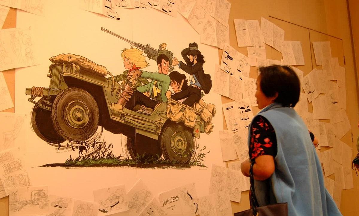写真・図版 : 大塚康生さんの原画展で=2002年10月、山口市のC・S赤れんが