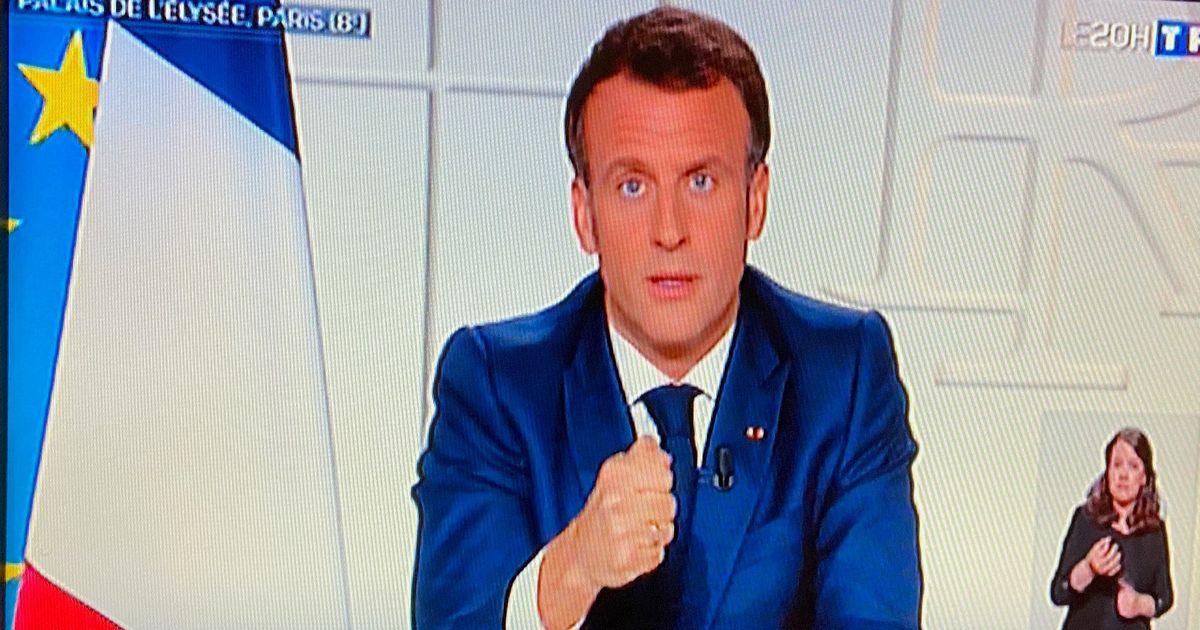 写真・図版 : 3回目のロックダウン宣言をするマクロン大統領=2021年3月31日、仏TF1テレビの画面から(山口昌子撮影)